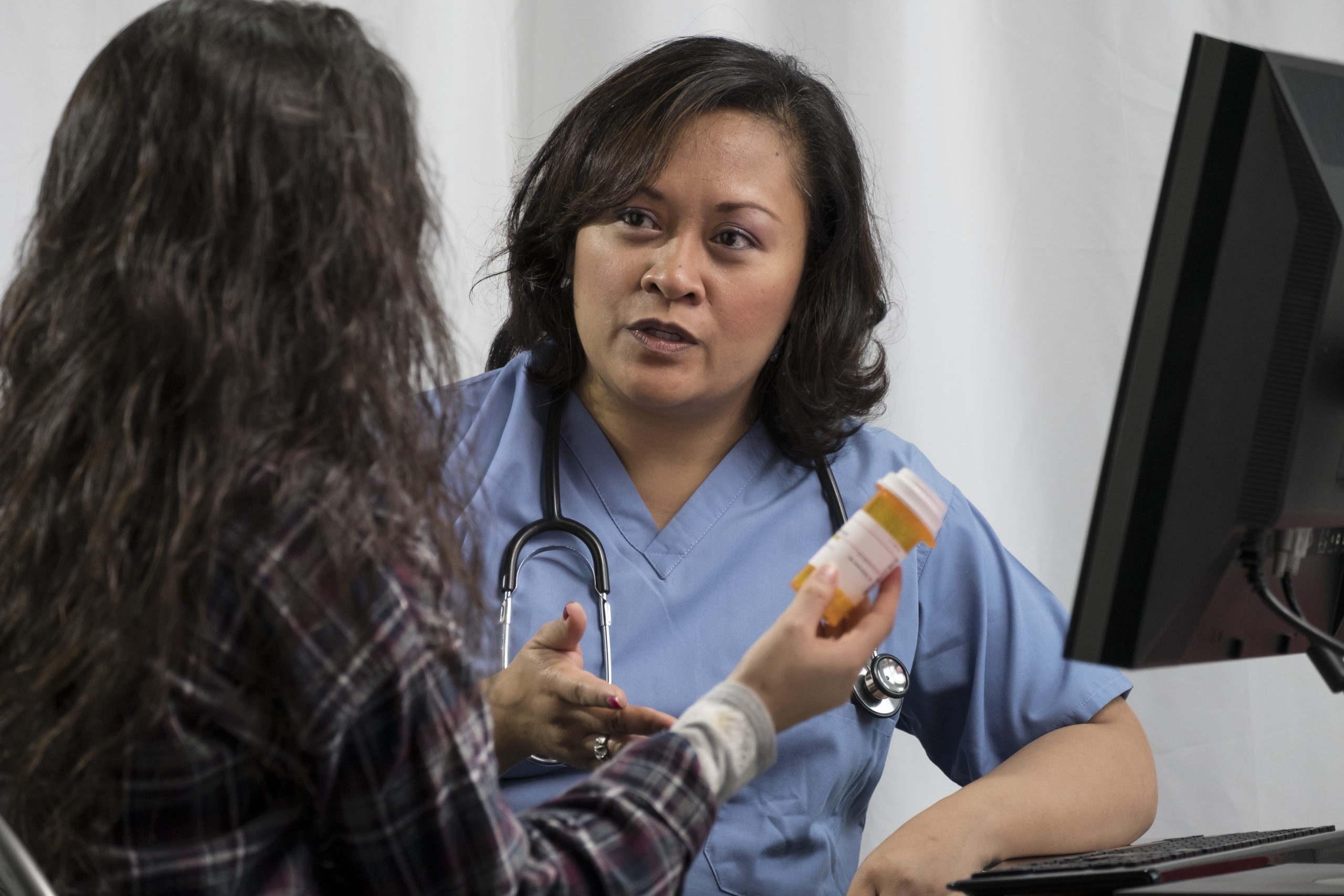 Female patient receiving prescription advice from health professional